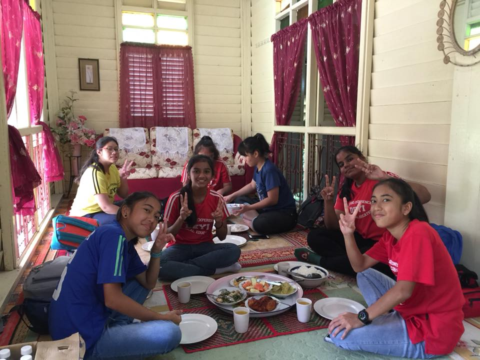 Traditional way of eating in a kampong house.jpg